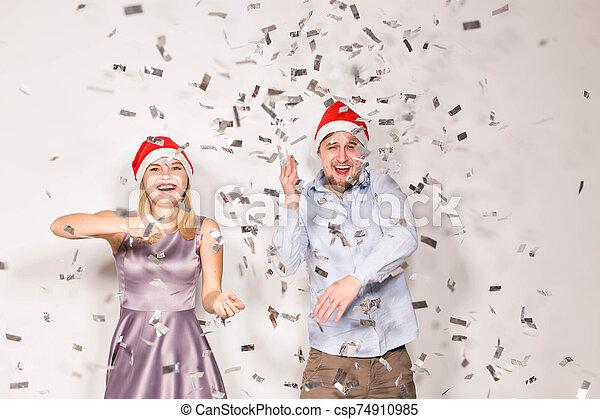 alegre, fiesta, confeti, fondo., regado, joven, nuevo, concepto, -, gente, navidad, blanco, año - csp74910985