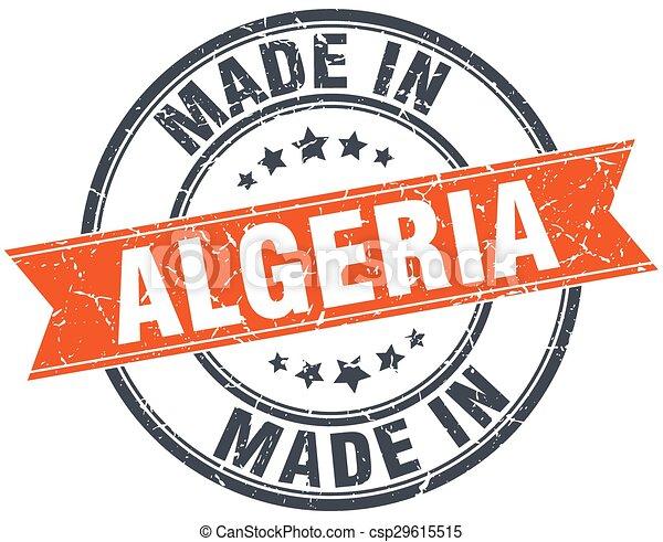 Algeria orange grunge ribbon stamp on white - csp29615515