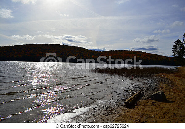 Algonquin Provincial Park, Ontario, Canada. Beautiful fall landscape with lake and mountains - csp62725624