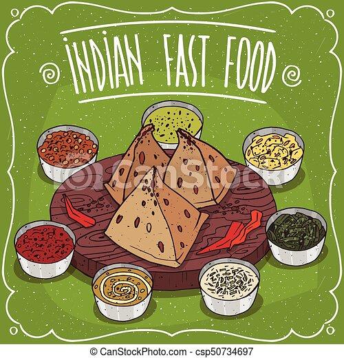 Tradicional comida rápida india samosa con salsas - csp50734697