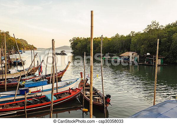 All fishing boat in the sea with color of sunlight - csp30358033
