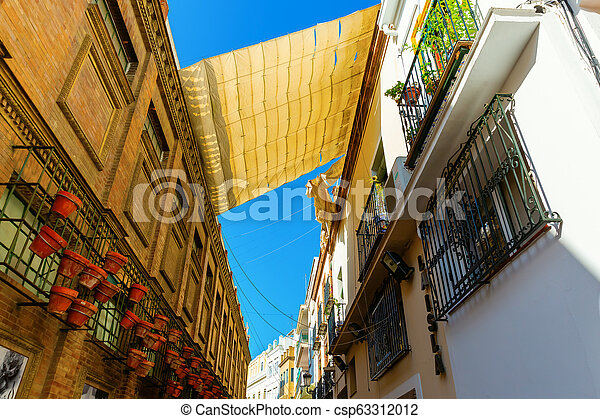 alley in the old town of Seville, Spain - csp63312012
