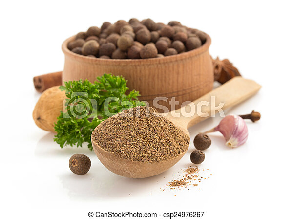 allspice in spoon on white background - csp24976267