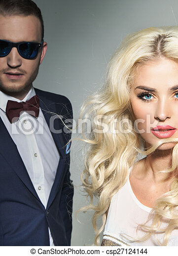 alluring blond lady with the handsome stock photo csp27124144