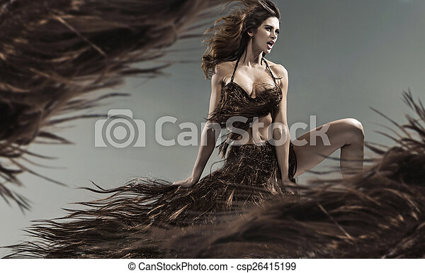 Alluring young brunette among the hair storm - csp26415199