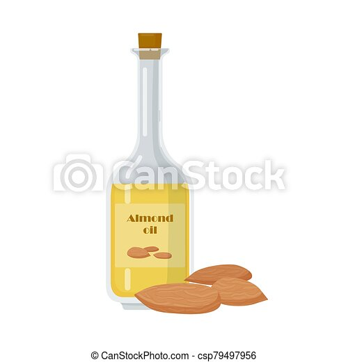 Almond oil in bottle with organic nuts. - csp79497956