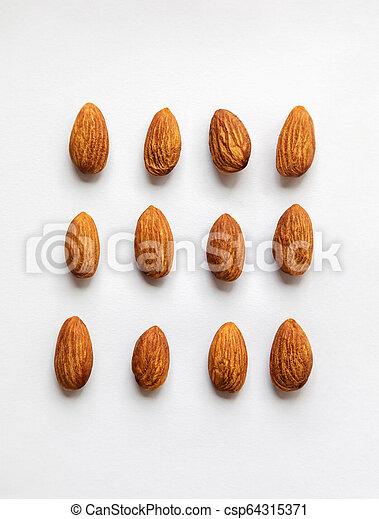 Almond on white background. - csp64315371