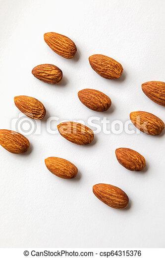 Almond on white background. - csp64315376