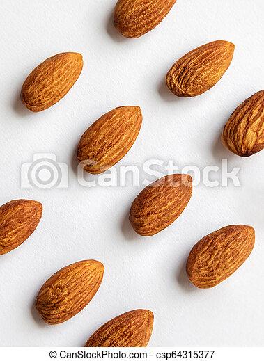 Almond on white background. - csp64315377