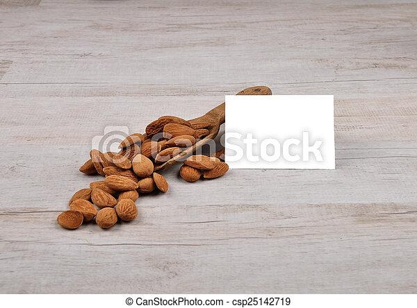 Almonds on shovel - csp25142719