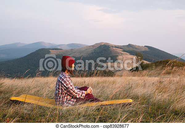Alone girl in autumn mountains - csp83928677