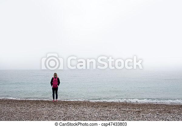 Alone girl stay near sea - csp47433803