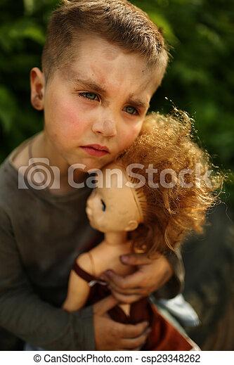 alone sad child on a street - csp29348262