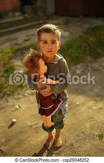 alone sad child on a street - csp29348252