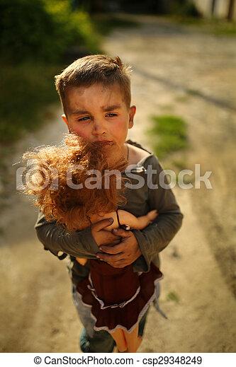 alone sad child on a street - csp29348249