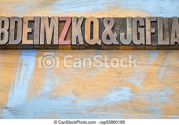 alphabet abstract in letterpress wood type - csp55860189