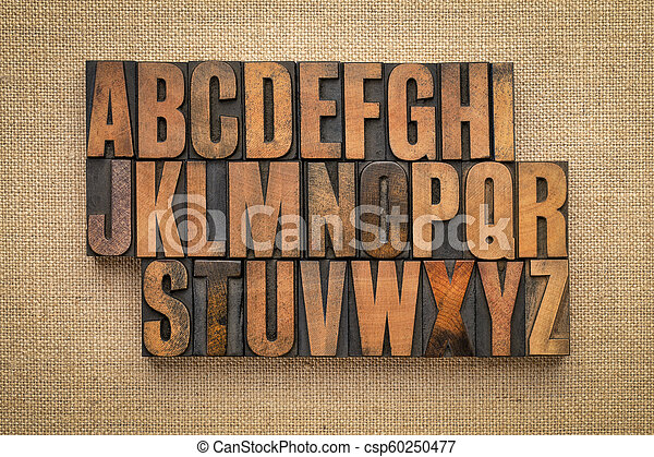 alphabet abstract in vintage wood type - csp60250477