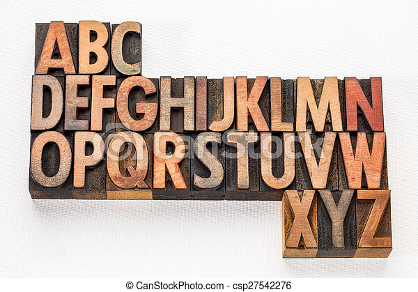 alphabet abstract in wood type - csp27542276