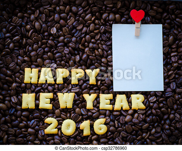 "alphabet "" happy new year 2016"" made from bread cookies on coffee beans background - csp32786960"