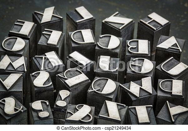 alphabet in metal type - csp21249434