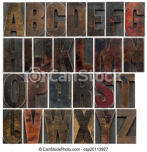 alphabet in old dark wood type - csp20113927