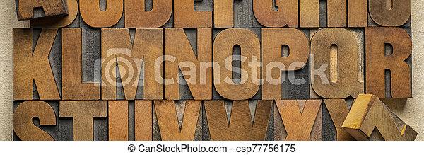 alphabet in vintage letterpress wood type printing blocks - csp77756175