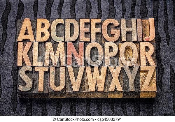 alphabet in vintage letterpress wood type - csp45032791