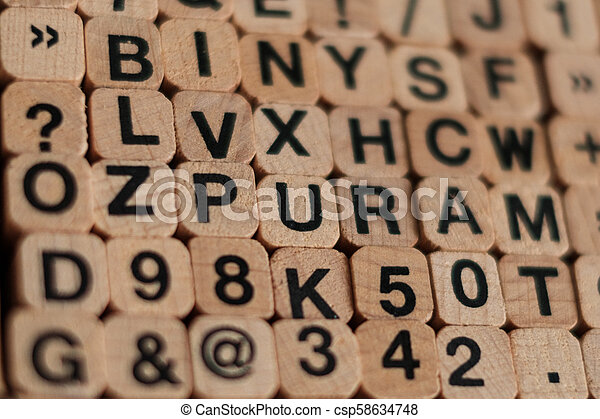 alphabet letters, numbers on wood cubes letter stamp - csp58634748