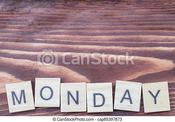 Alphabet Monday on old vintage wood - csp85397873
