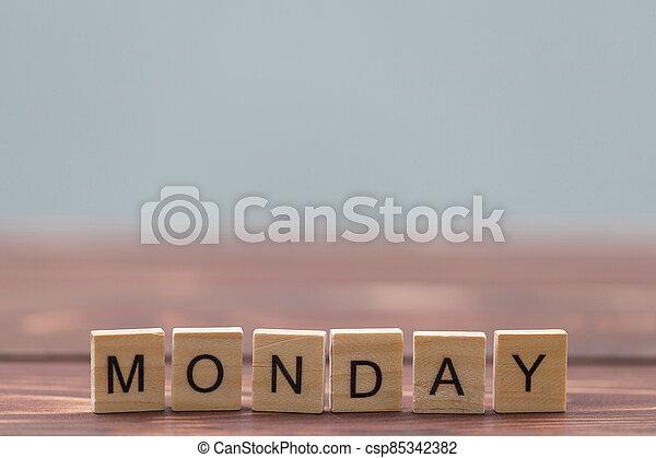 Alphabet Monday on old vintage wood - csp85342382