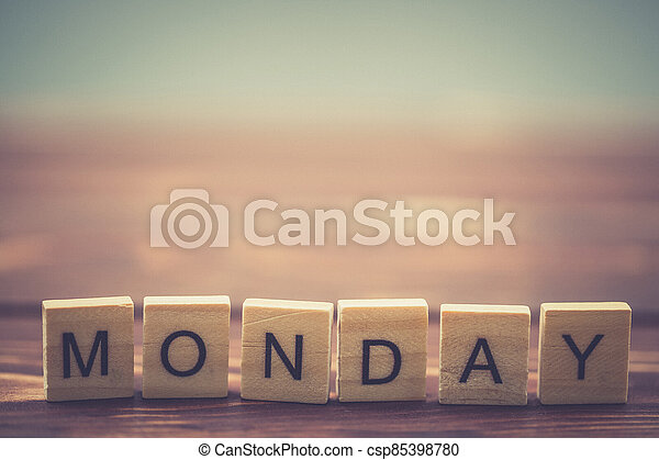 Alphabet Monday on old vintage wood - csp85398780
