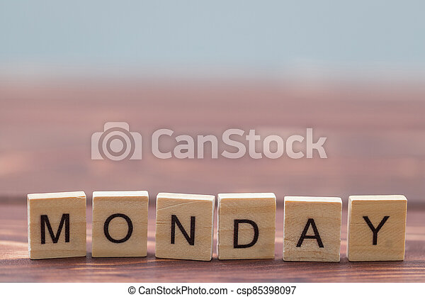 Alphabet Monday on old vintage wood - csp85398097