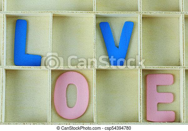 alphabet of LOVE in wooden box. - csp54394780