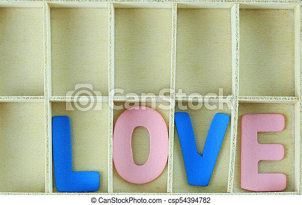 alphabet of LOVE in wooden box. - csp54394782