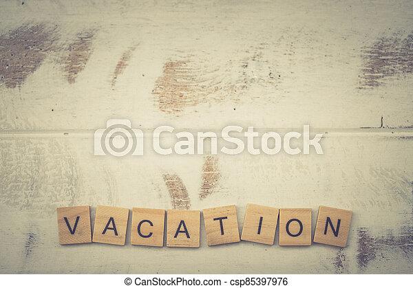 Alphabet Vacation on old vintage wood - csp85397976