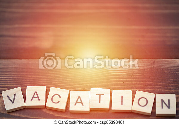 Alphabet Vacation on old vintage wood - csp85398461
