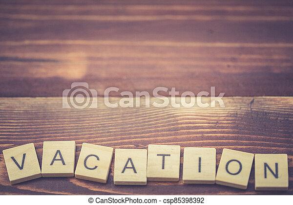 Alphabet Vacation on old vintage wood - csp85398392