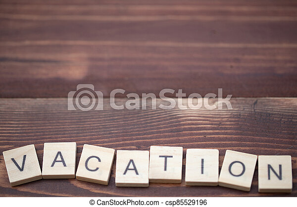 Alphabet Vacation on old vintage wood - csp85529196