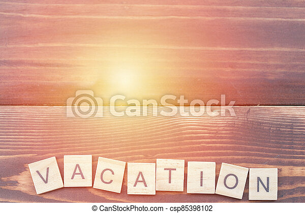 Alphabet Vacation on old vintage wood - csp85398102