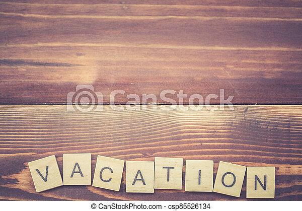 Alphabet Vacation on old vintage wood - csp85526134
