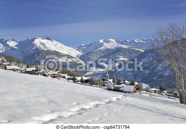 alpine french village in snowy mountain - csp64731794
