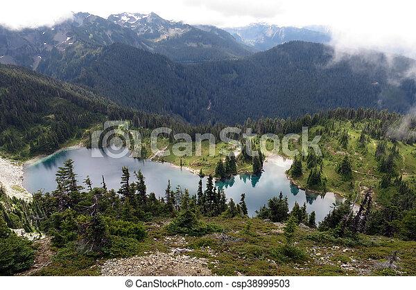 Alpine Lake in the Clouds - csp38999503