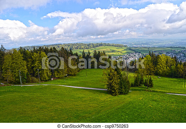 Alpine landscape in Austria: mountains, forests, meadows and a farm - csp9750263