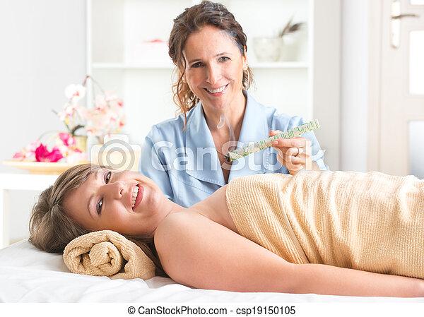 Alternative medicine therapist doing moxa treatment - csp19150105