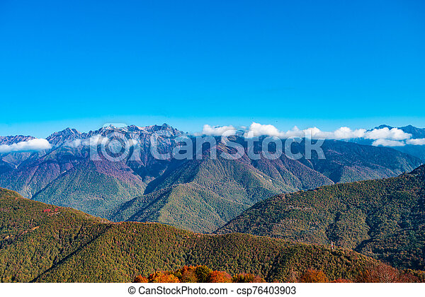 Amazing aerial view of the Alps at sunny autumn day - csp76403903