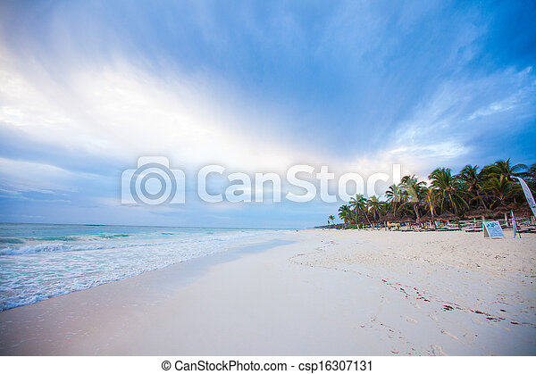 Amazing colorful sunset on the beach in Mexico - csp16307131
