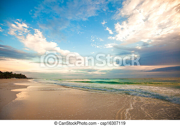 Amazing colorful sunset on the tropical beach in Mexico - csp16307119