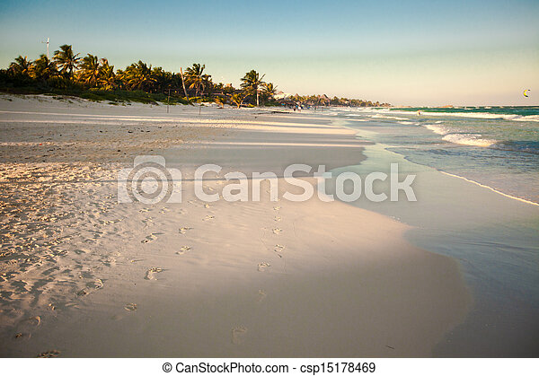 Amazing colorful sunset on the tropical beach in Mexico - csp15178469