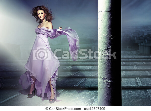 Amazing picture of sensual brunette wearing lilac dress - csp12507409