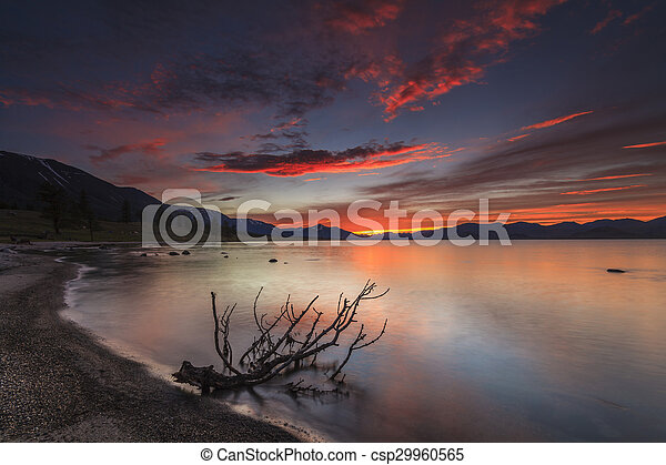 Amazing red sunset over a mountain lake. - csp29960565